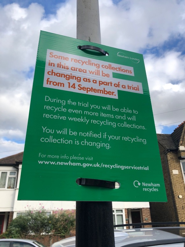 Sign on street informing residents about the recycling trial